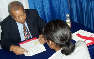 McClatchy Corporate Recruiter Reginald A. Stuart interviews a candidate at a job fair.