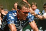 Lance Armstring on bicylce, blue jersey
